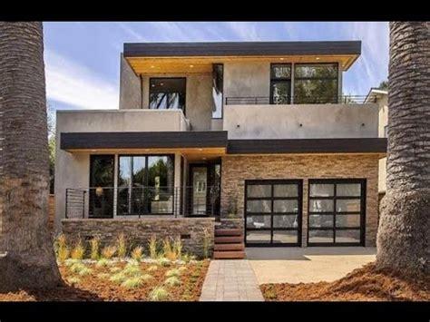 de una casa moderna con grandes ventanales fachadas de casas con ventanas grandes