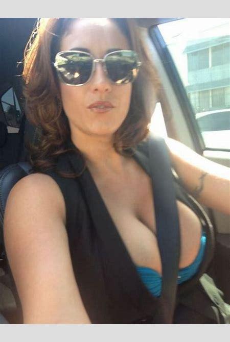 Busty MILF with seatbelt in between her big tits – MILF Update