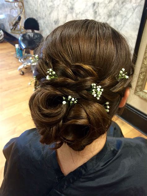 Prom hair. Braids and baby's breath   Hair by Chloe