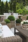 Modern Country Style: Using Grey Rattan Kubu Chairs In french country outdoor patio furniture