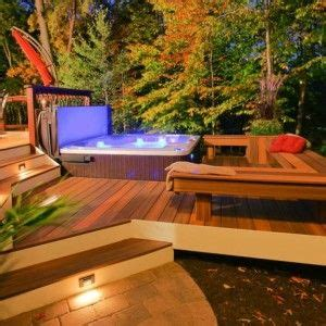 beautiful deck  hot tub featuring built  benches