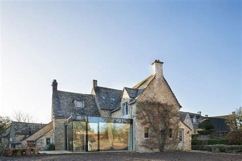 century british cottage   glassy modern extension
