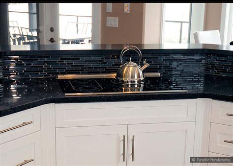 black glass tiles for kitchen backsplashes backsplash goes black cabinets home design inside