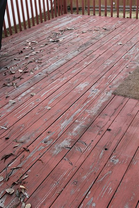 stain the deck by covering the old existing stain with a