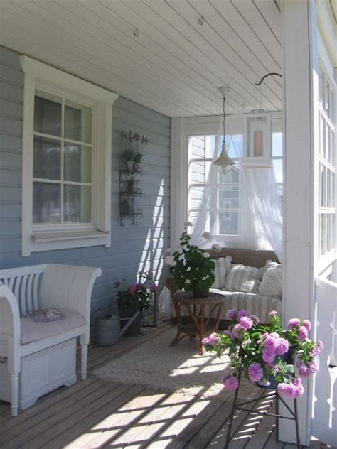 porch love seat rest area whitewashed cottage
