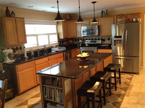 image black granite countertops with oak cabinets