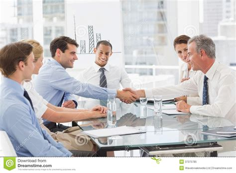 Business People Making A Deal At A Meeting Stock Image