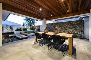 Water Feature, Outdoor Dining Table, Stone Wall, House in