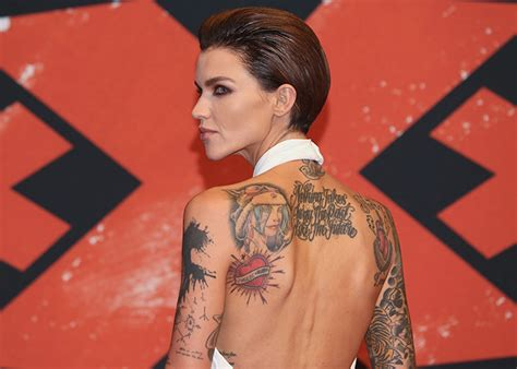 ruby rose jess origliasso tattoo ruby rose stuns in a white jumpsuit on the red carpet