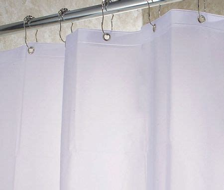 clean shower curtain liner on delicate cycle in the
