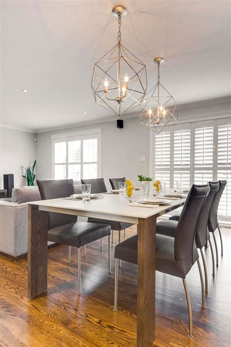 Modern Dining Room Lighting by Modern Dining Room Design With Silver Caged Hanging Light