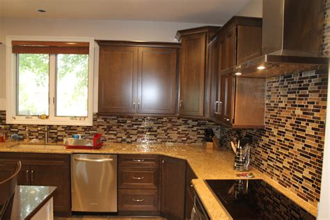 dark kitchen cabinets with light countertops medium maple cabinets with light granite countertops and