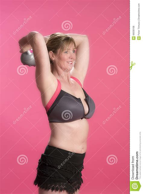 head kettle exercise bell using woman knees behind preview
