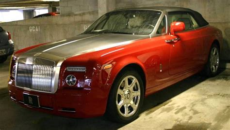 ensign red  rolls royce drophead coupe