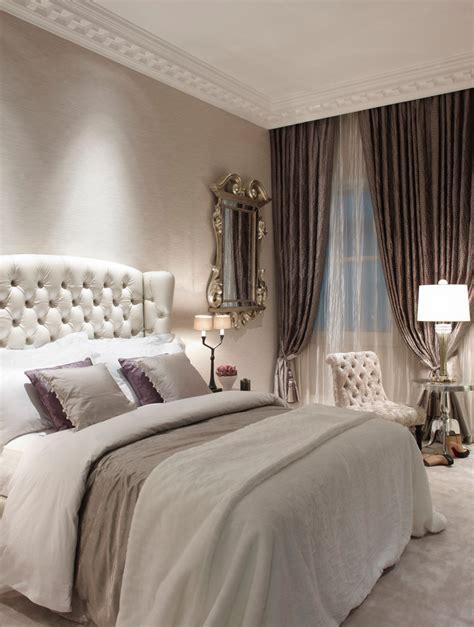 gray bedroom with beige bedding beige carpet beige