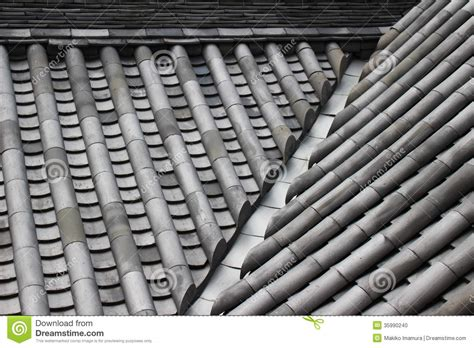 ceramic roof tiles of a japanese castle stock photo