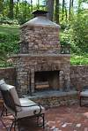 Outdoor Stone Fireplace Warming Up Exterior Space - Traba outdoor patio fireplace
