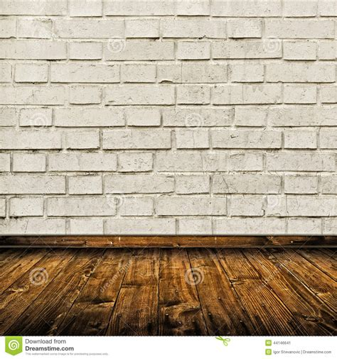 white brick floor room interior with white brick wall and wooden floor stock photo image 44146641