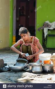 Teenage Indian girl washing dishes outside her rural ...