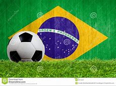 Soccer Ball On Grass With Brazil Flag Background Royalty