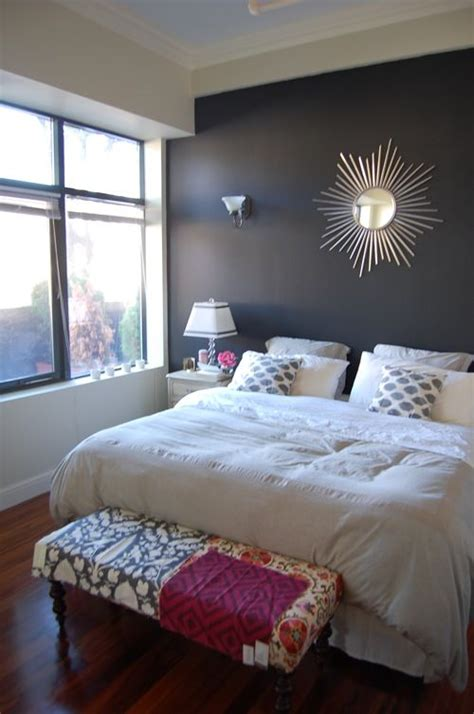 bedroom king sized bed white bedding gray walls