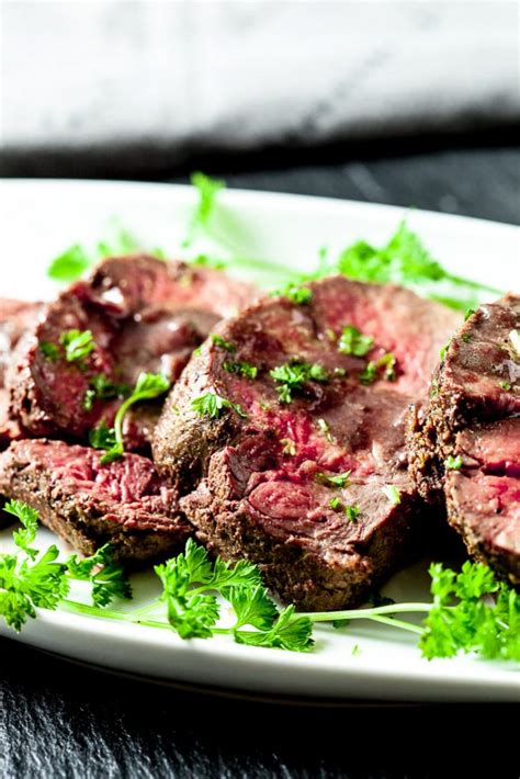 The other trick is roasting the beef on top of the pan sauce, which not only flavors the meat, but also humidifies the oven for a moist, aromatic cooking environment. Beef Tenderloin Roast with Red Wine Sauce | Chew Out Loud
