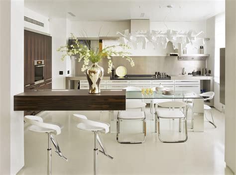 attractive white  shaped kitchen design featuring white