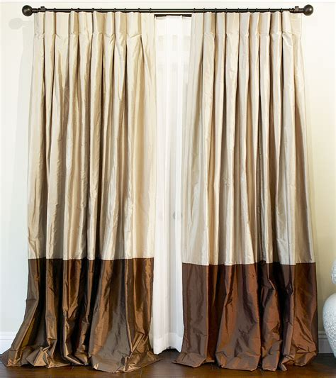 made custom bordered silk drapes and blinds on
