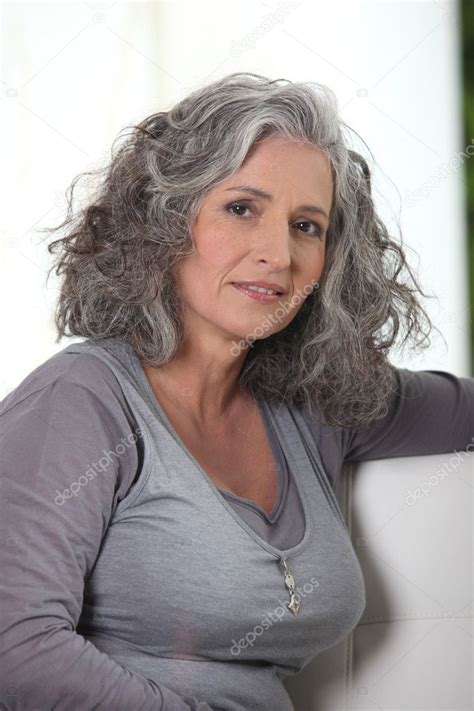 grey haired retired woman   lot   time stock