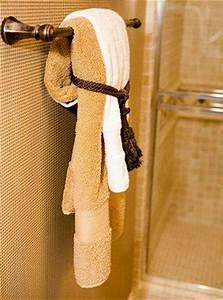 How to display bath towels slideshow for How to tie towels in bathroom