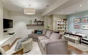 Light Basement Family Room Houzz Basement Family Room Medberian Basement And Tenant Finishing Absolute WoodworX That Society Will Eventually Correct Itself And Will Develop Into Wood Love A 1990 S Cottage Turned Into A Bright Contemporary Home By