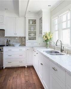 Painting kitchen cabinets our favorite colors for the job for Kitchen colors with white cabinets with labrador wall art