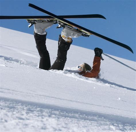 fallen skier lying  powder snow escapingabroadcom
