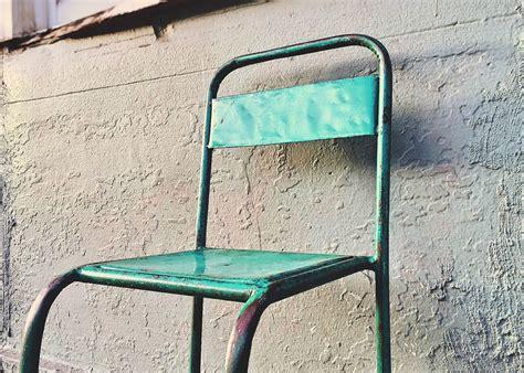 picture chair abandoned broken rusty steel