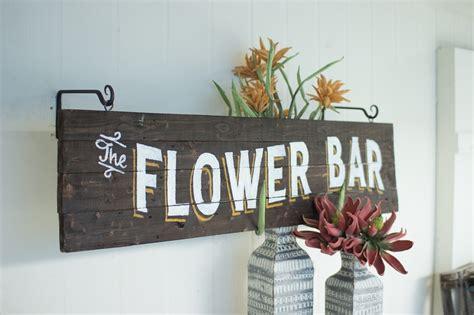wooden flower bar sign
