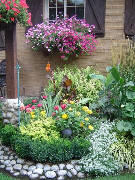 bed with flowers garden spot gardens to die for pinterest rocks gardening and flower beds