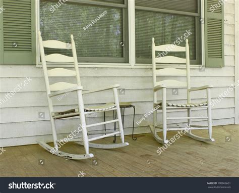 two white painted wooden rocking stock photo 100866661