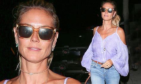 Heidi Klum wears sunglasses at night as she treats her ...