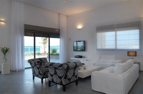 large white curtains add a touch of class to this living