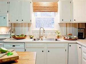 Do it yourself diy kitchen backsplash ideas hgtv for What kind of paint to use on kitchen cabinets for corn hole stickers