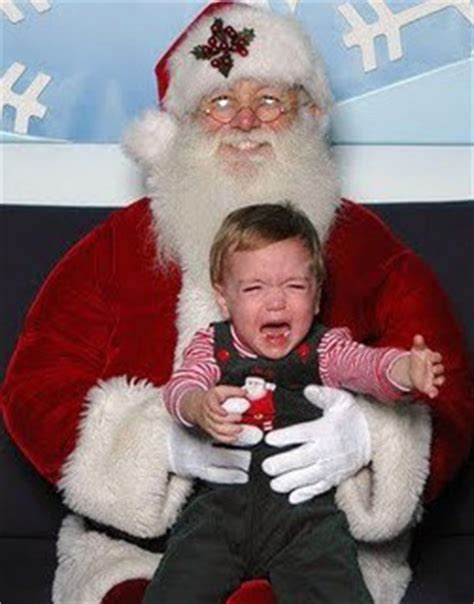 14 Pics Of Kids Crying With Santa