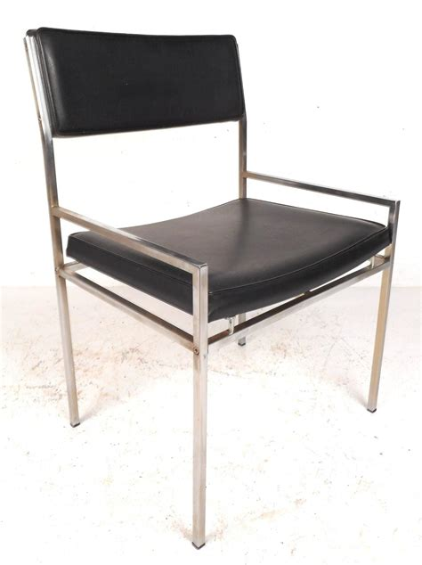 set of mid century modern chrome and vinyl dining chairs