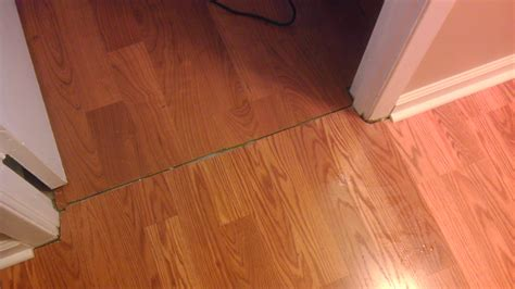 transition for laminate flooring door transition quarter jpg quarter for transition