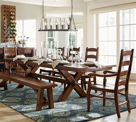 It's crafted with a distressed top and eased edges, and designed to maximize legroom and serving space. Toscana Extending Dining Table, Seadrift | Pottery Barn