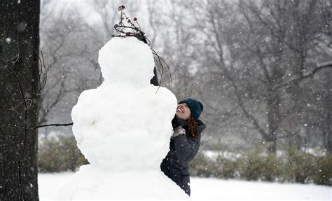maryland snow storm leaves icy glaze  travel hazards