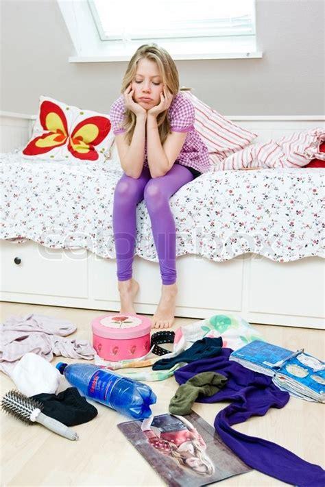 depressed teenage girl   messy bedroom stock