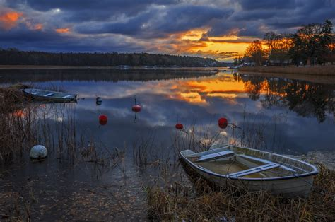 boats   quiet forest lake  sunset wallpapers