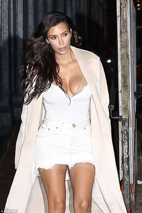 Kim Kardashian puts on eye-popping display in plunging top ...