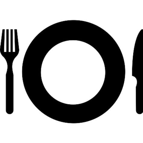 Plato con el tenedor y cuchillo herramientas para comer en