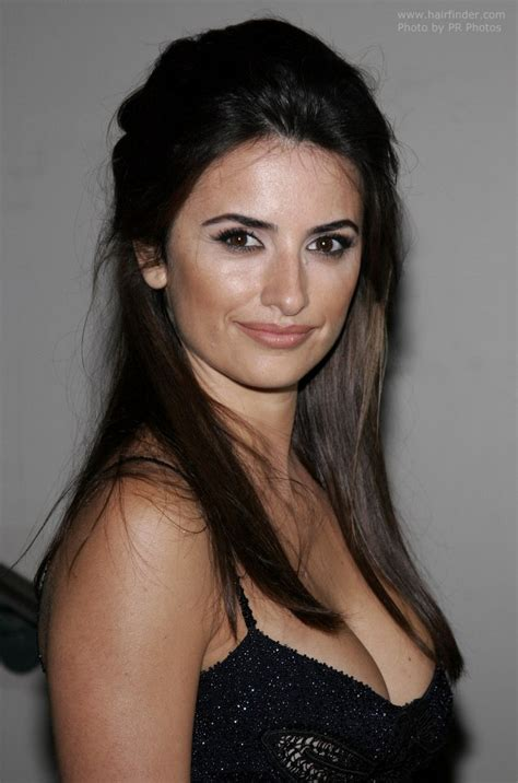Penelope Cruz's long hair with the sides brought back and